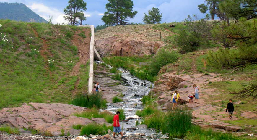 Children playing in the stream below the Luna Lake spillway