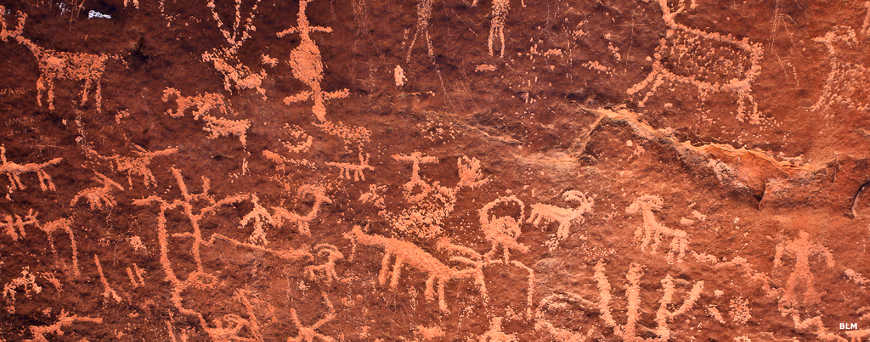 Petroglyphs carved into the red sandstone by the hands of ancient artists