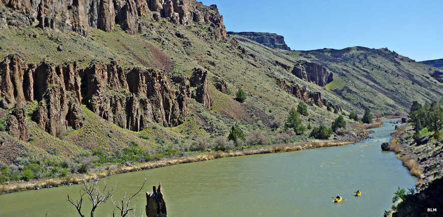 A view of the Owyhee river with kayakers on the water