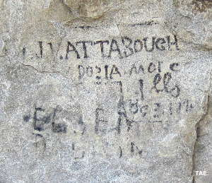 Signatures written in axle grease at Register Rock on City of Rocks National Preserve, along the California Trail in Idaho