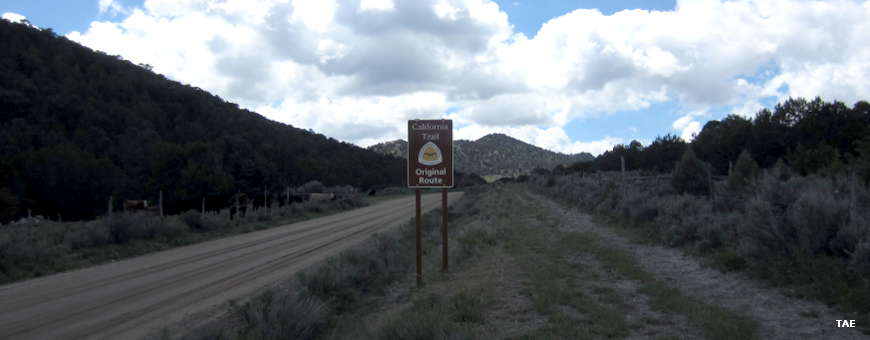 Sign marking the California Trail next to wagon wheel ruts