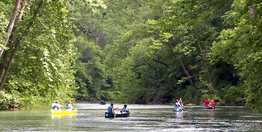 Canoes and kayaks on the Current River in Ozark National Scenic Riverways
