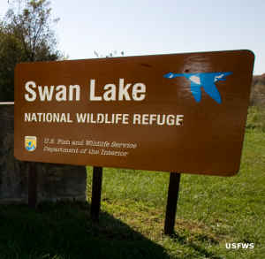 Sign marking Swan Lake Nationmal Wildlife Refuge