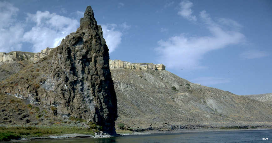 A view floating past a volcanic plug at the river's edge in Upper Missouri River Breaks National Monument
