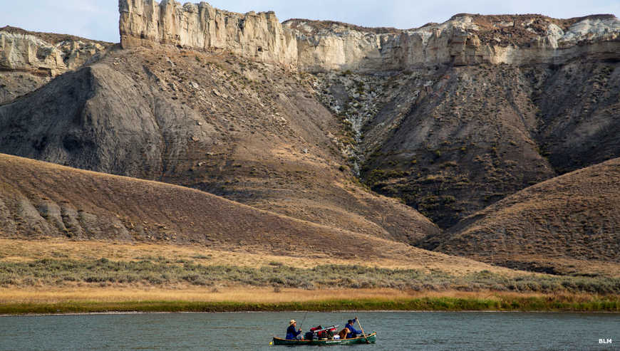 Floating and fishing on the Missouri River beneath tall limestone cliffs in the Upper Missouri River Breaks National Monument