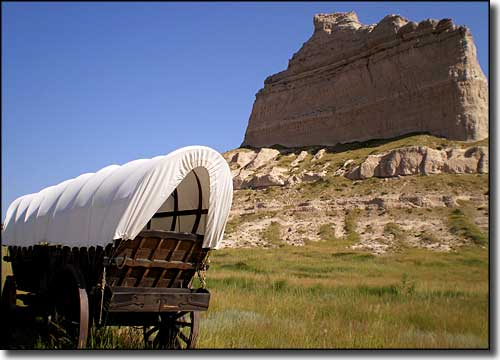Covered wagon below Scotts Bluff