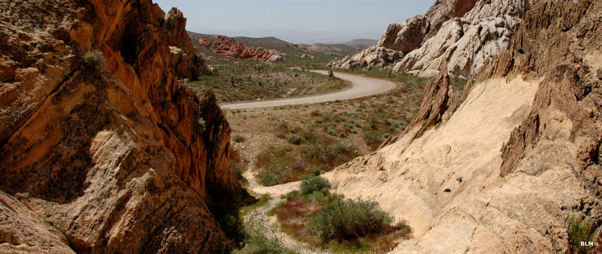 Looking through a canyon on a hiking trail toward the Gold Butte Backcountry Byway