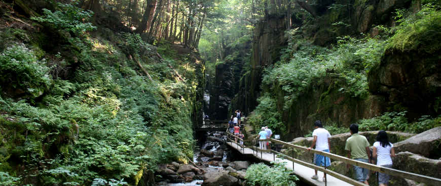 People on the boardwalk through Flume Gorge at Franconia Notch State Park