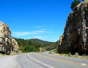 Passing through a cut in the ridge south of Tijeras in Cibola National Forest