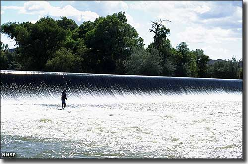 Fisherman below the dam at Percha Dam State Park