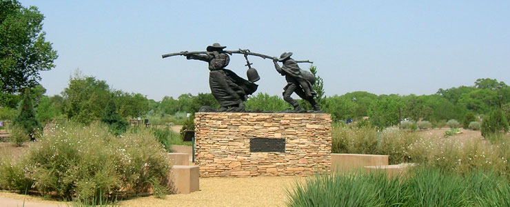 A statue honoring the founders of Los Ranchos