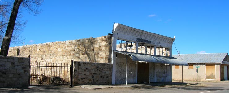 An old mercantile across the street from the old railroad station in Watrous