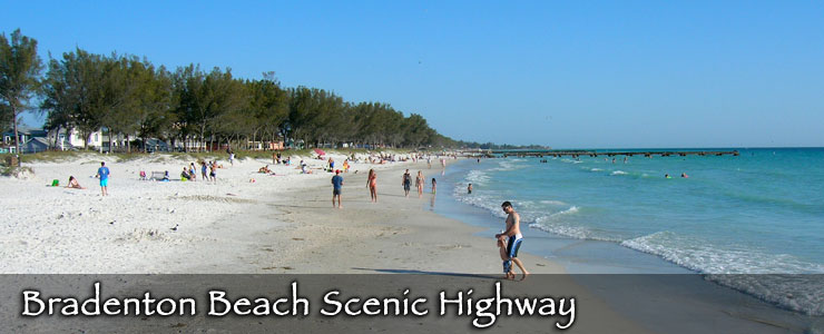 Lots of people playing in the sand and waves on a beach along the Bradenton Beach Scenic Highway