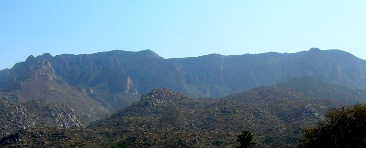 Looking across the cliffs and formations at the top of Sandia Wilderness