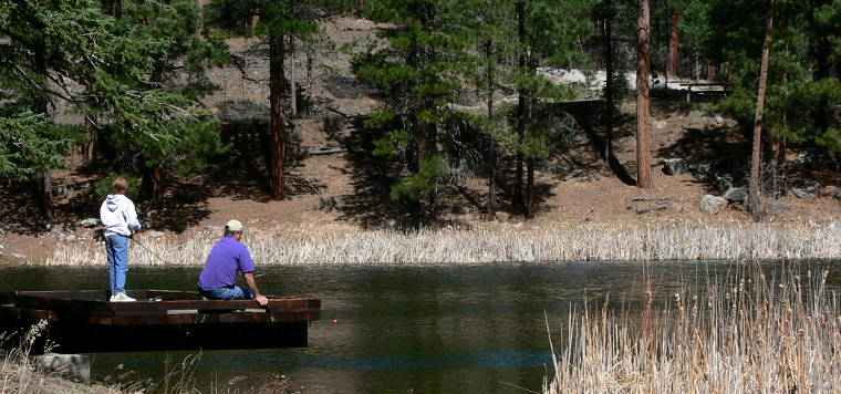 Fishing in a lake along the Wildlife Loop Road Scenic Byway
