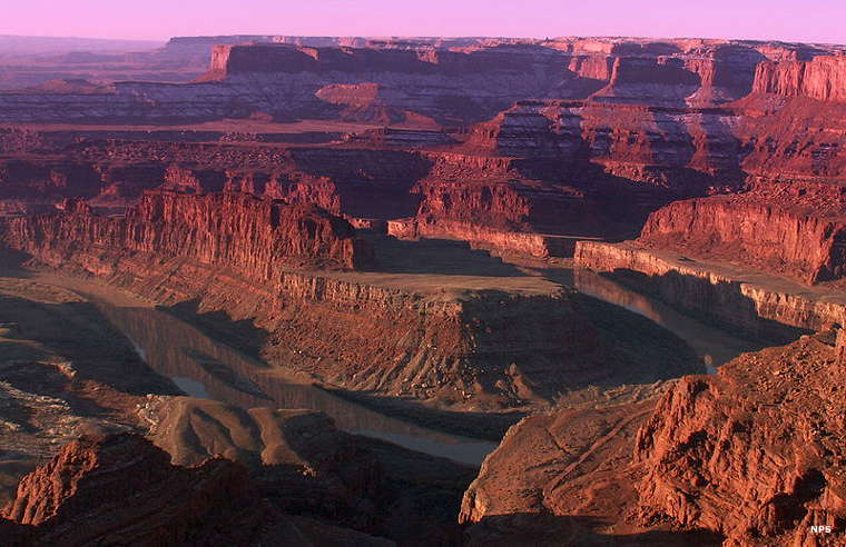 Looking down on the red cliffs lining the Colorado River Canyon from Dead Horse Point State Park
