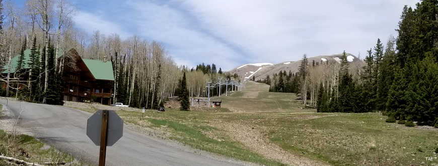 A view from the foot of the ski slope up past the chairlift to the summit of Delano Peak