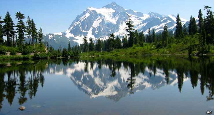 Mount Shuksan rises behind Picture Lake along the Mount Baker Highway
