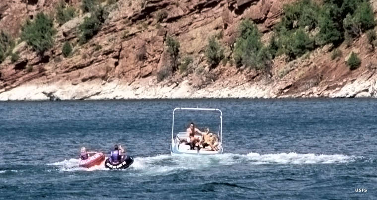 Boat towing tubers on Flaming Gorge Reservoir