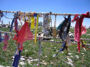 Pieces of cloth tied to the rope fence around the Medicine Wheel National Landmark