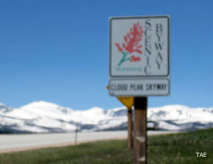 A Cloud Peak Skyway marker with the snowy Bighorn Mountains spine in the background