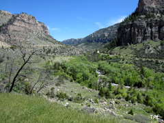 The U-shaped valley of Ten Sleep Canyon, complete with conifer forest, rushing stream and limestone cliffs rising above
