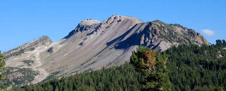 A bald knob above steep talus slopes high up in Owens River Headwaters Wilderness