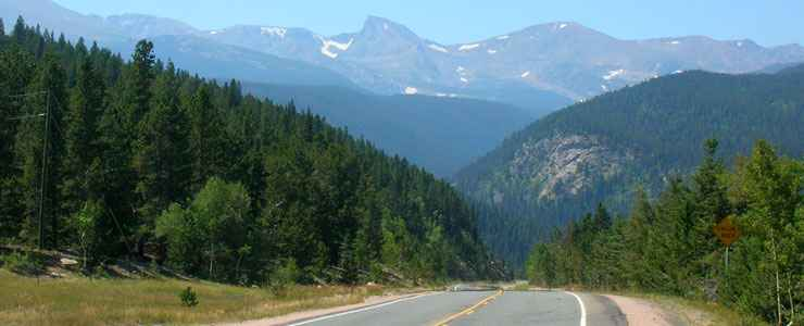 Looking at the Indian Peaks Wilderness while driving on the Peak to Peak Scenic Byway