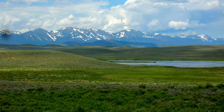 A view across the wetlands to the mountains at Arapaho National Wildlife Refuge