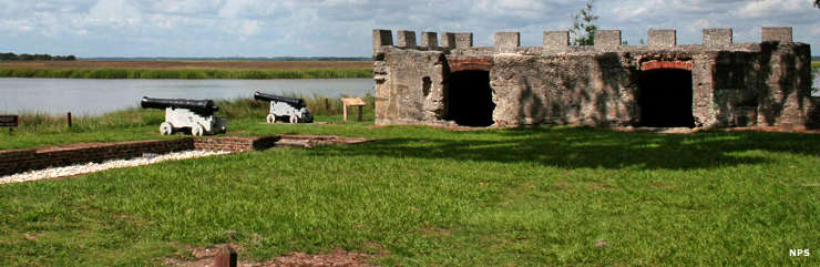 Fort Frederica and a couple cannons stand guard over wetlands