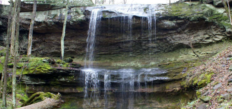 A waterfall flows over a rocky ledge on Crab Orchard National Wildlife Refuge