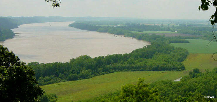 Looking down on the bottomlands of the Mississippi Riuver with farms and humid haze in the distance