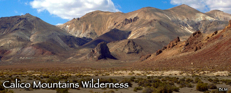 Rock formations, barren desert and multi-colored peaks in the Calico Mountains Wilderness