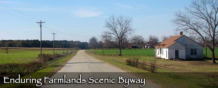 Farmhouses and plowed fields along the Enduring Farmlands Scenic Byway